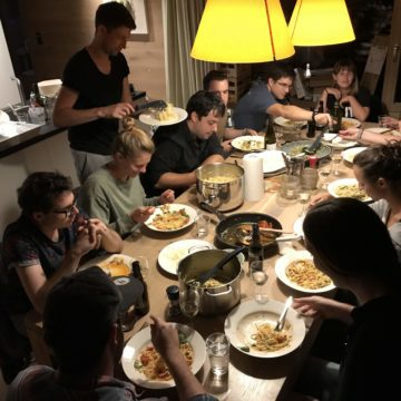Timeular team eating on a big table at the team retreat in Austria